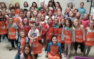 Arts and Craft Club Receives New Aprons from The Home Depot