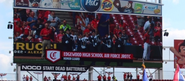 Scoreboard at GABP featuring the JROTC Color Guard